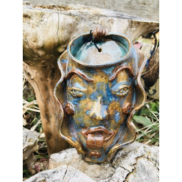 Face sconce in stoneware Clay